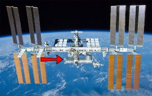 A view of the International Space Station with a red arrow pointing at the Columbus External Payload Facility