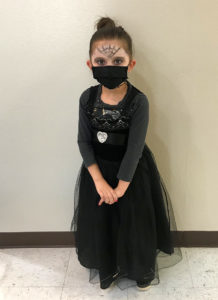 A student dressed for the Day of the Dead